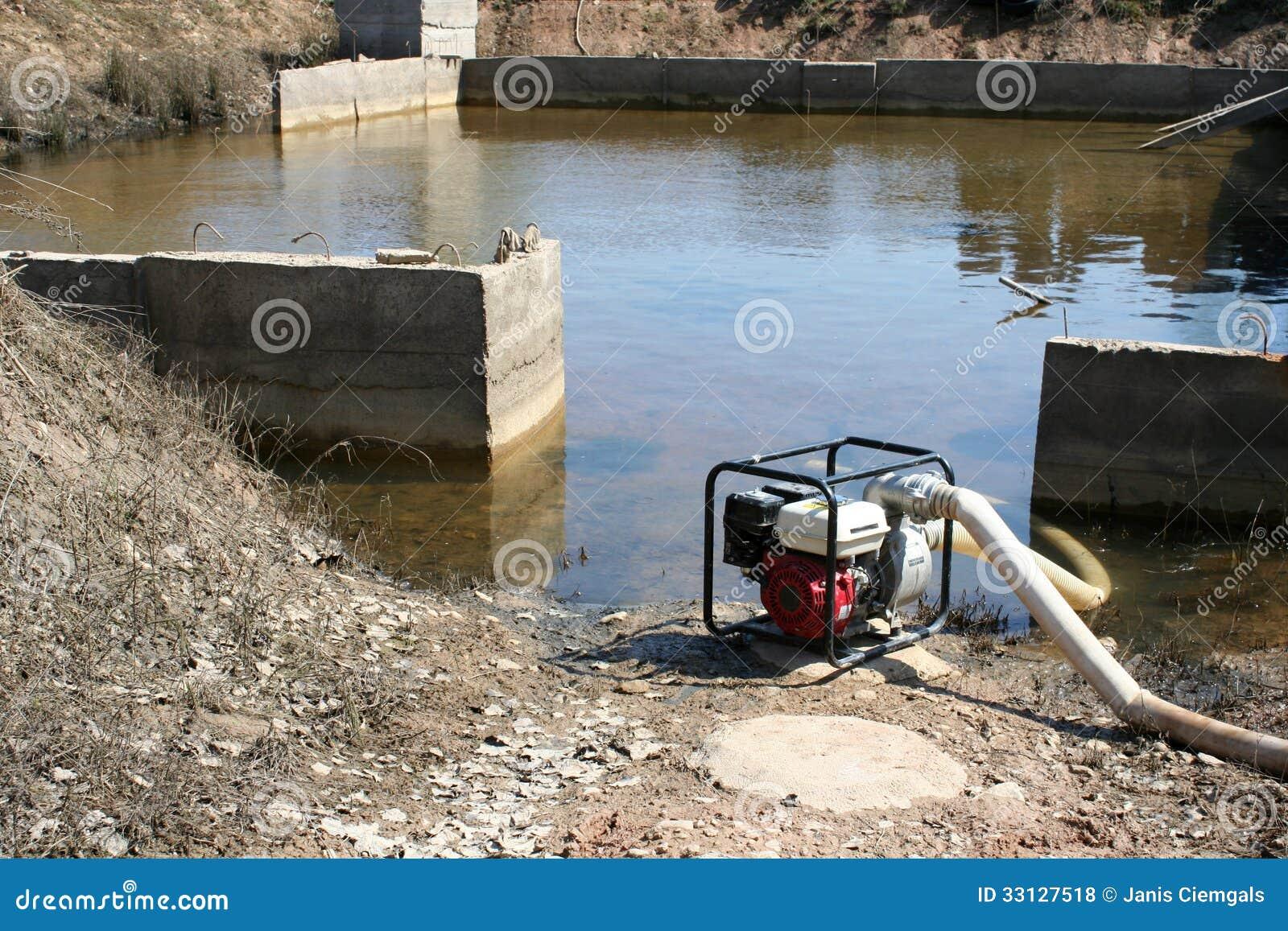 pumping water basement stock photo image of waterpump 33127518 rh dreamstime com water pump basement water pump basement floor