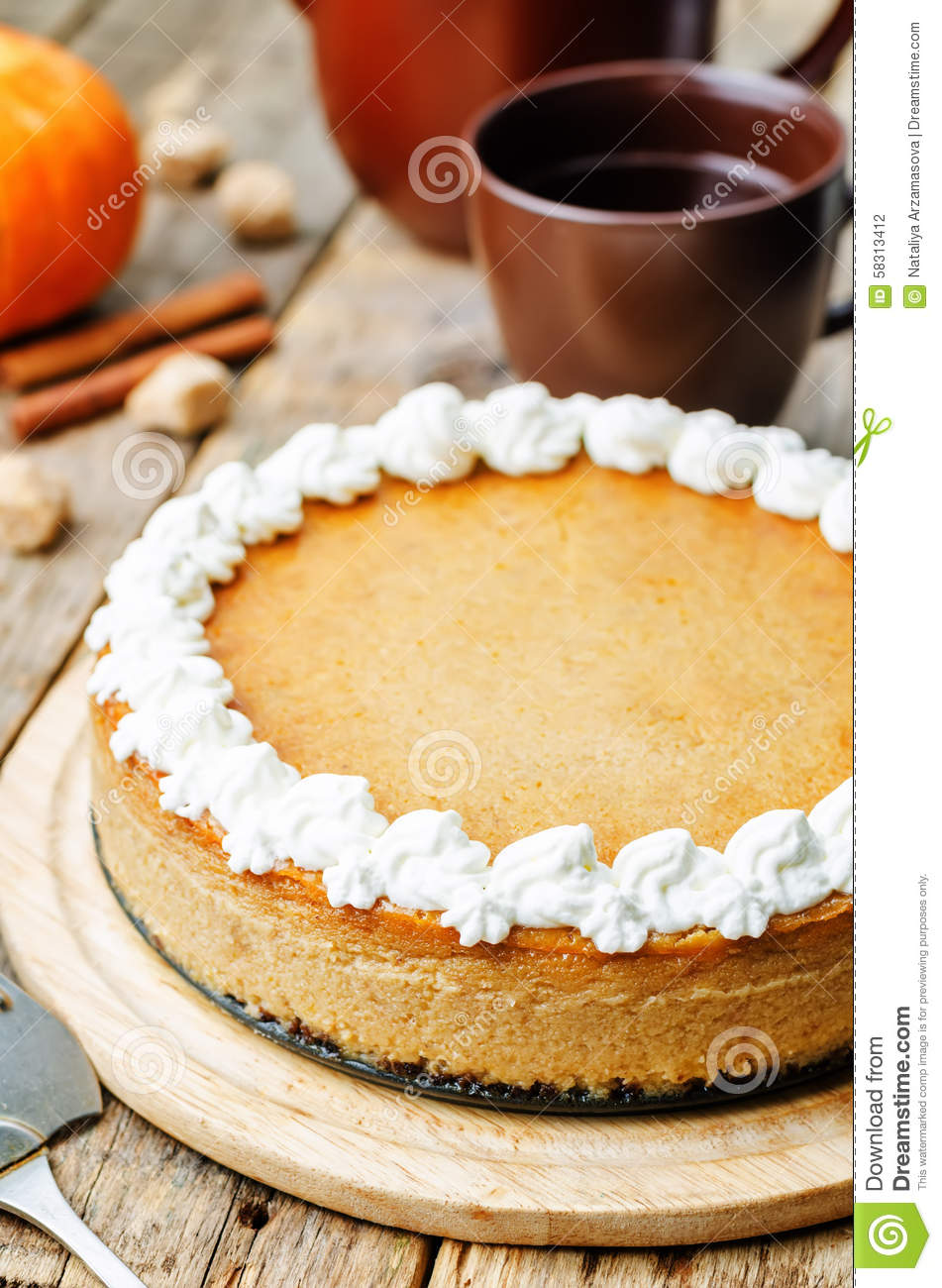 Pumpkin Cheesecake Decorated With Whipped Cream Stock Photo ...