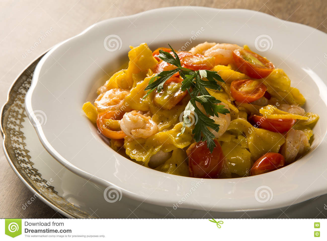 Pumpkin farfalle with shrimp and cherry tomato
