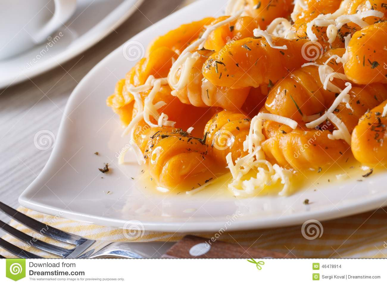 Pumpkin gnocchi with cheese and butter. Horizontal