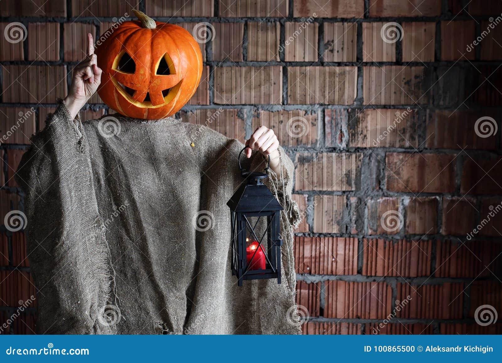 pumpkin head monster sign hand space halloween stock photo - image