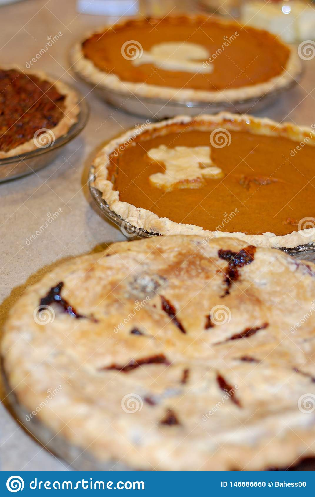 Pumpkin, pecan, and berry pie at Thanksgiving
