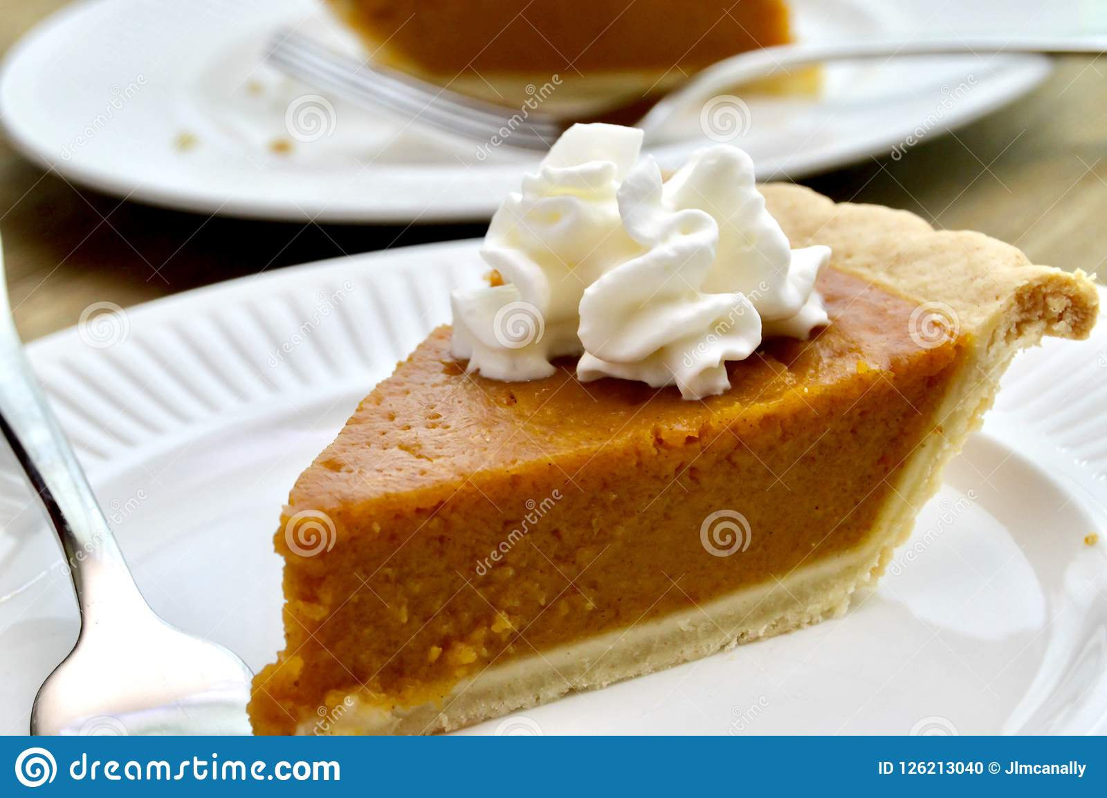 Pumpkin pie on a white plate