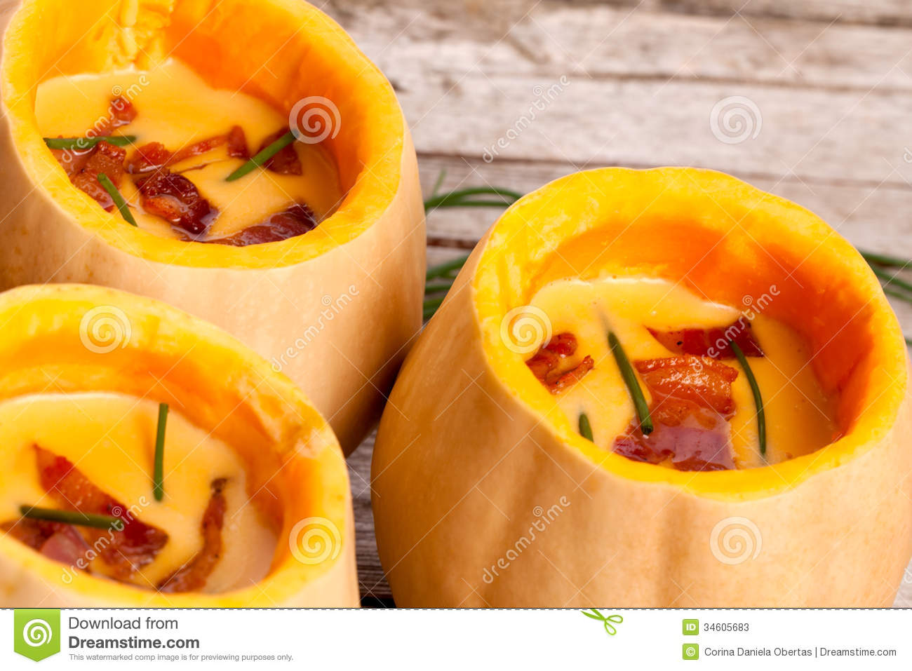 Cream of butternut squash and potatoes soup decorated with bacon and ...