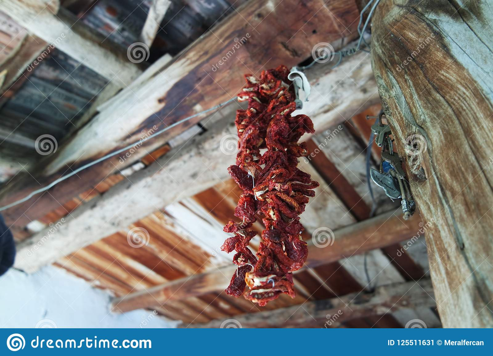 Dried peppers hanging on the ceiling.