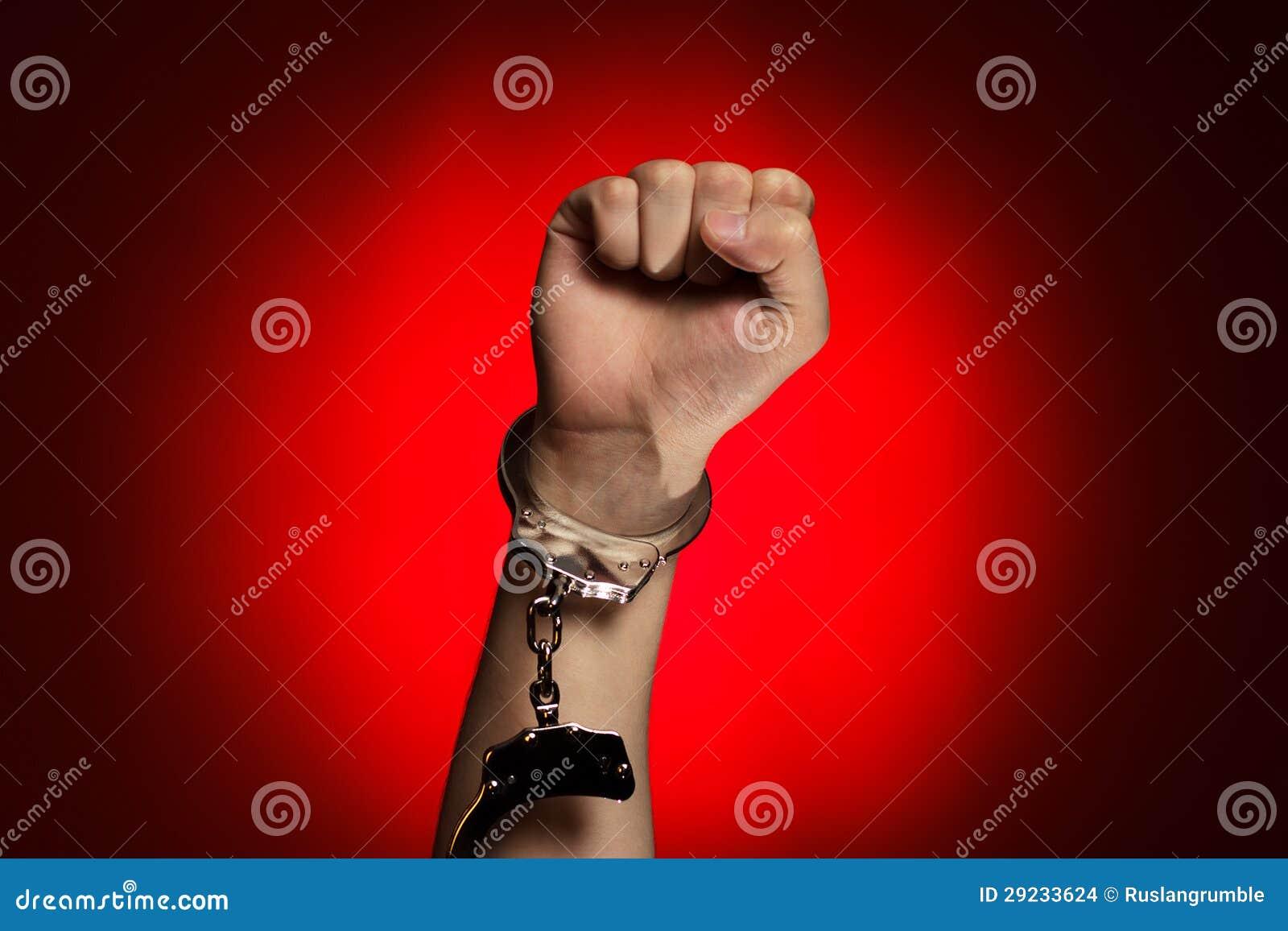 Download Punho E Algemas Abertos Sobre O Fundo Vermelho Foto de Stock - Imagem de wristbands, pessoa: 29233624