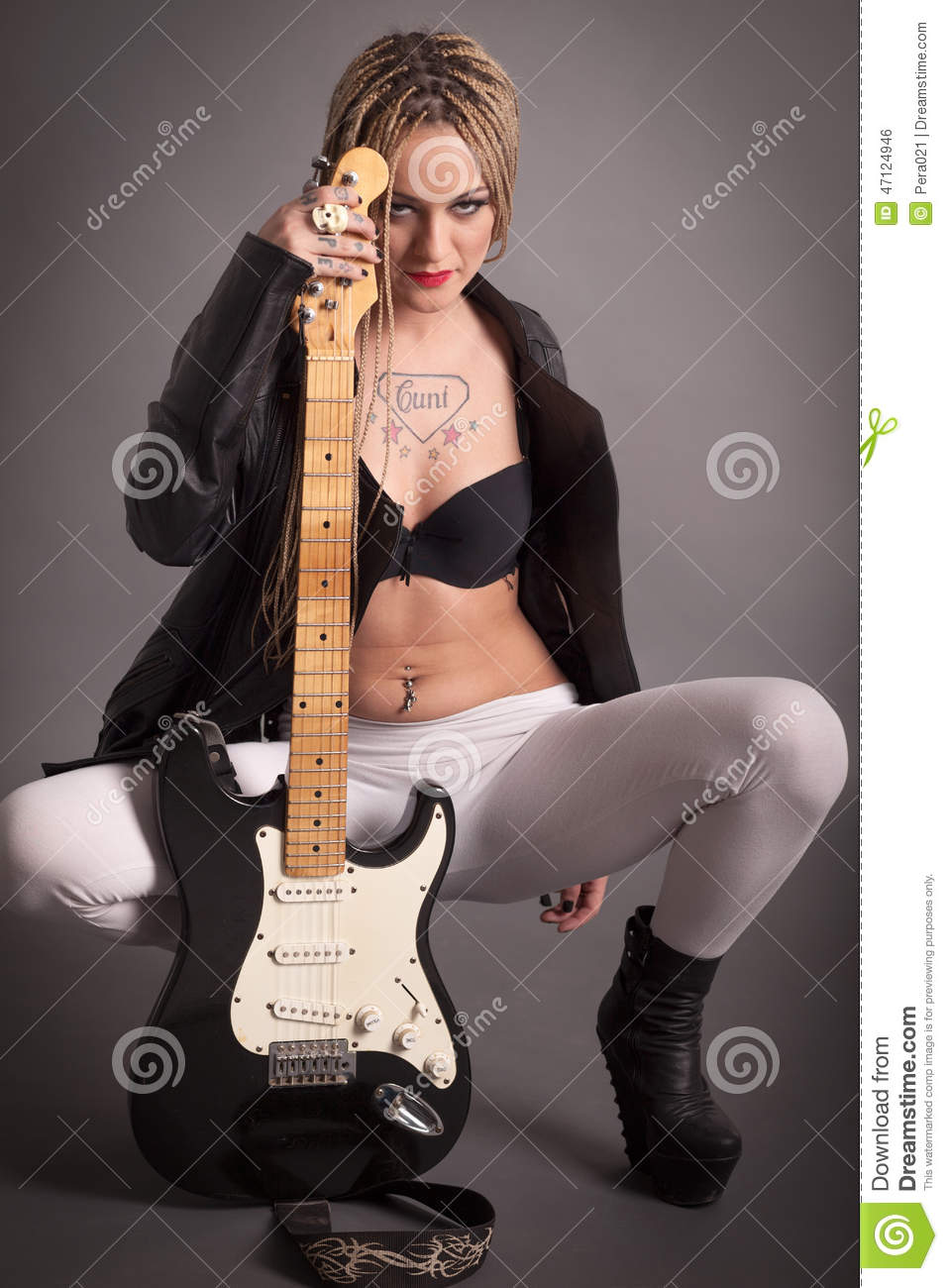 Punk Girl With Lots Of Tattoos And Electric Guitar Stock