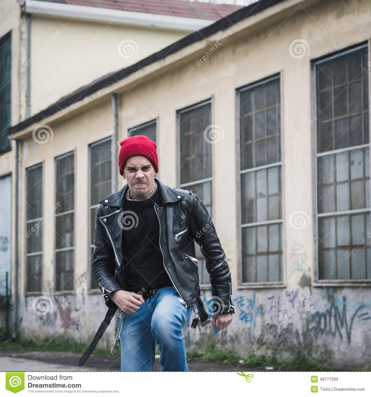 6bc348eedc5 Punk guy posing in the city streets stock image of look jpg 1300x1390 Beanie  hat grunge