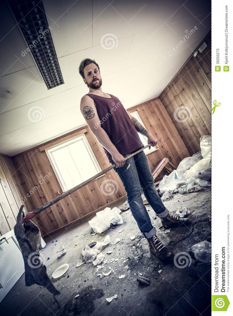 punk rocker clean up after party stock photo
