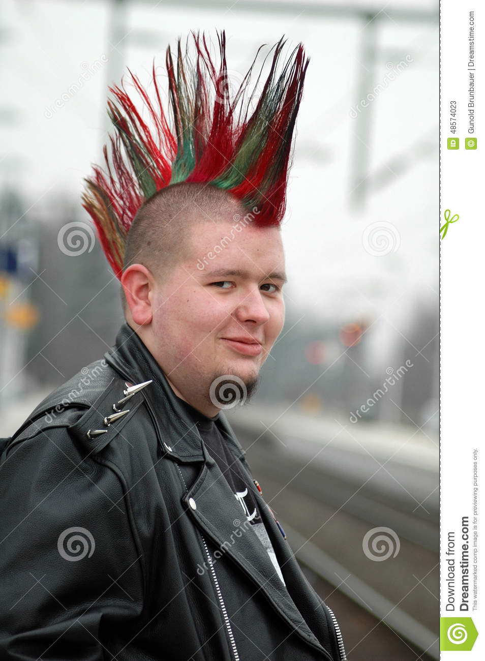 Portrait of Young man with punk Mohawk wearing a black leather jacket ...