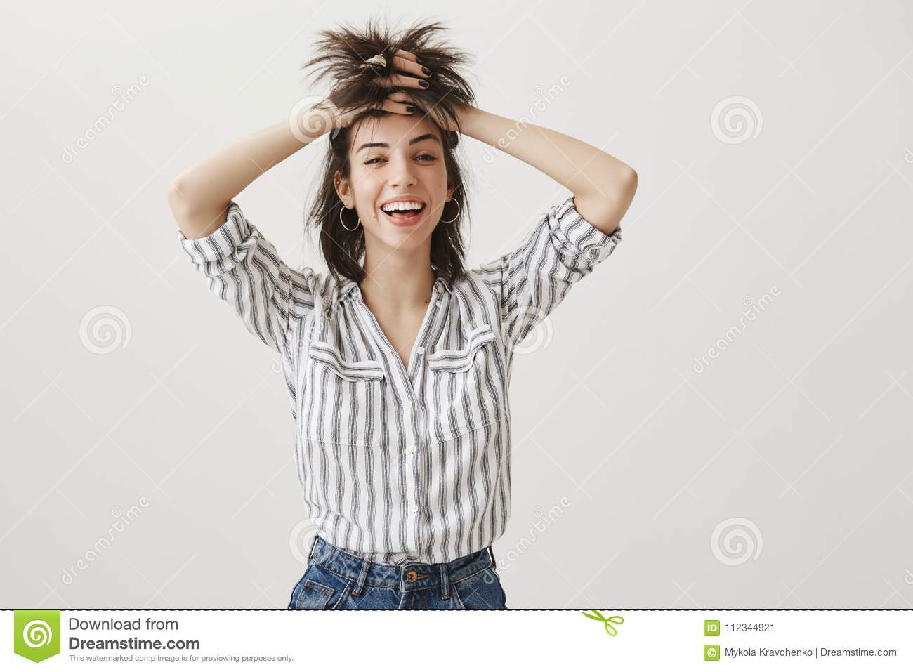 Punks not dead. Portrait of funny attractive woman with sense of humour lifting up hair with hands, looking like rock n