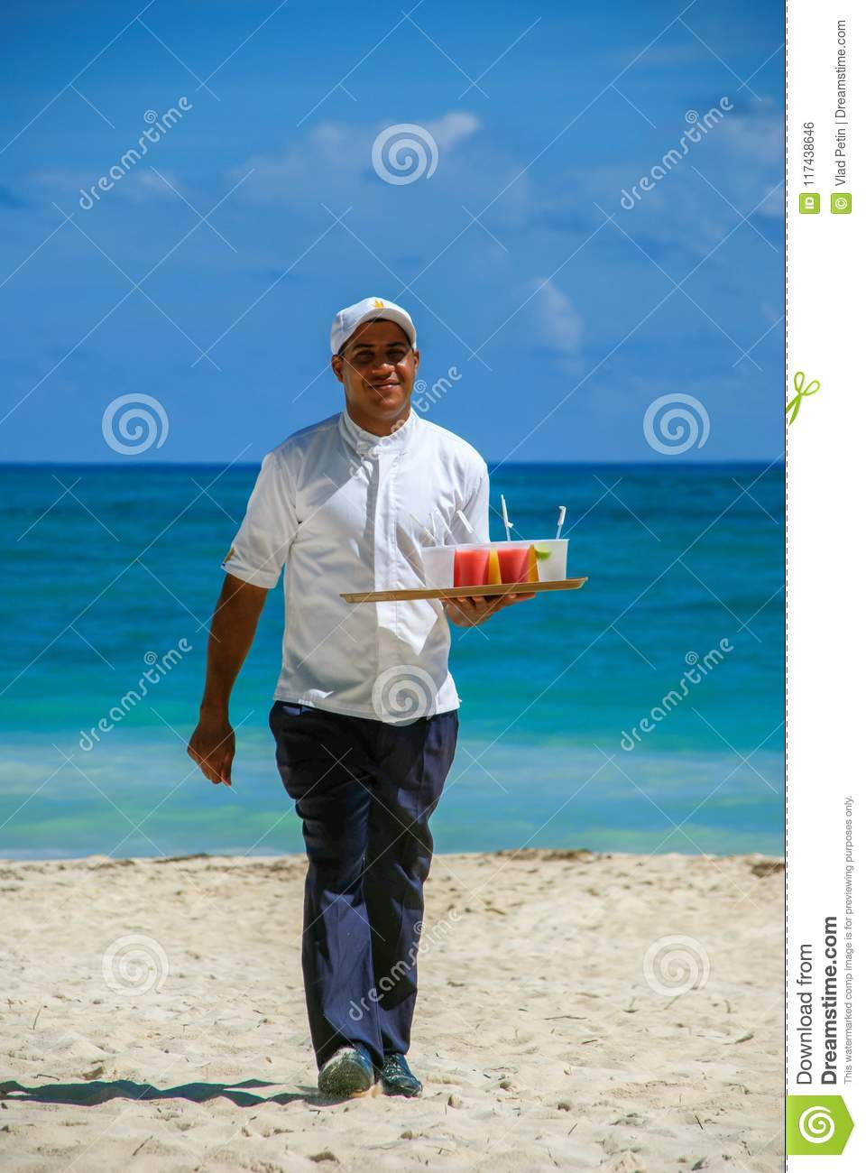 Waiter carrying cold drinks on beach