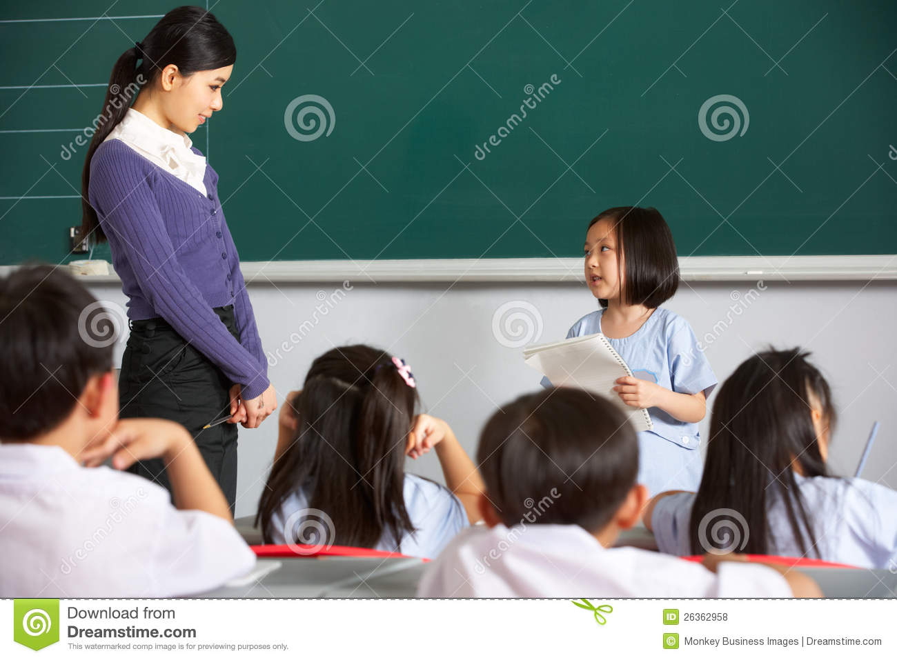 Pupil And Teacher By Blackboard In Chinese Class Royalty Free Stock ...