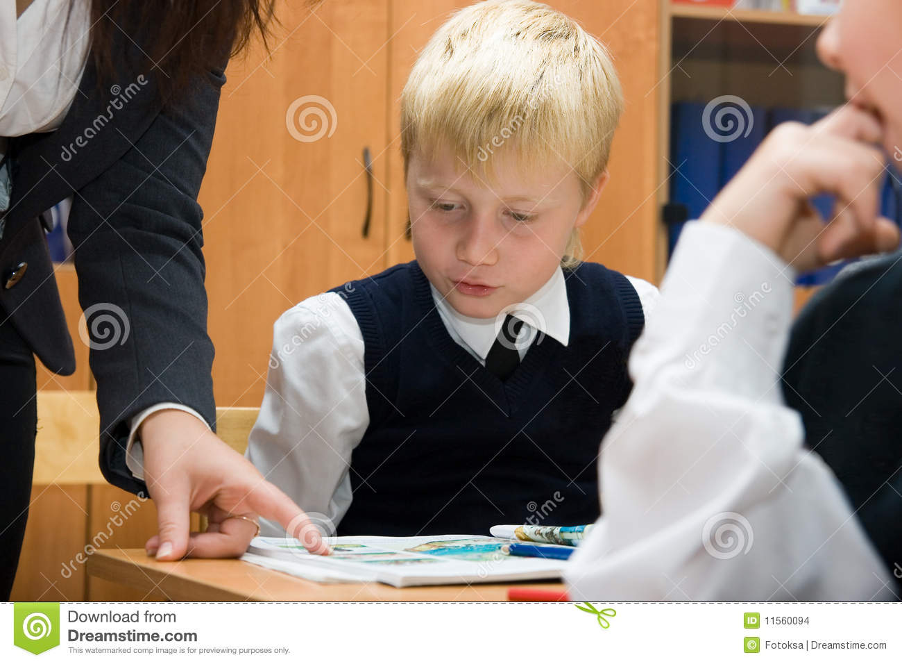 Pupil and teacher at the lesson in the classroom