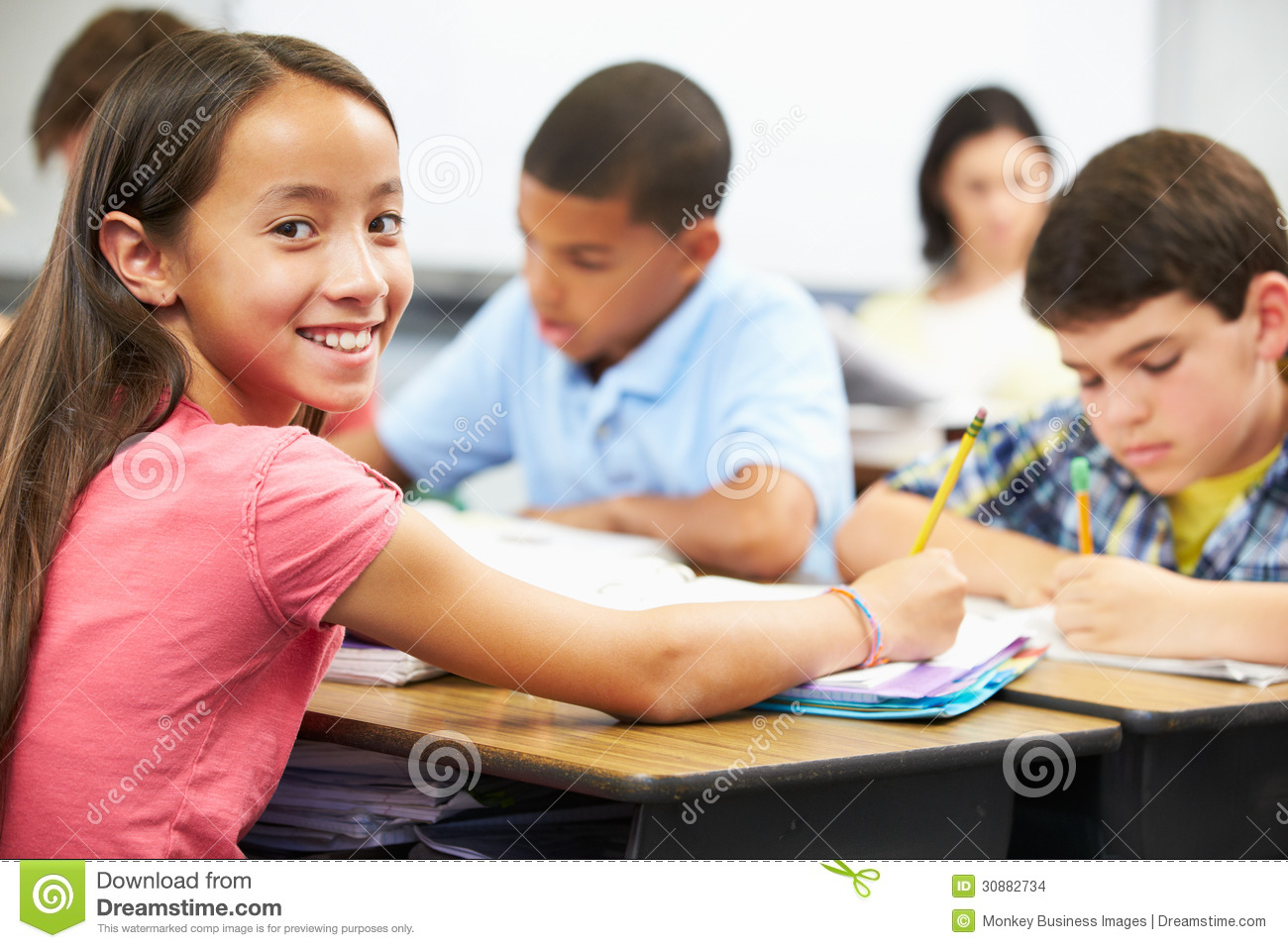 Pupils Studying At Desks In Classroom Stock Images Image