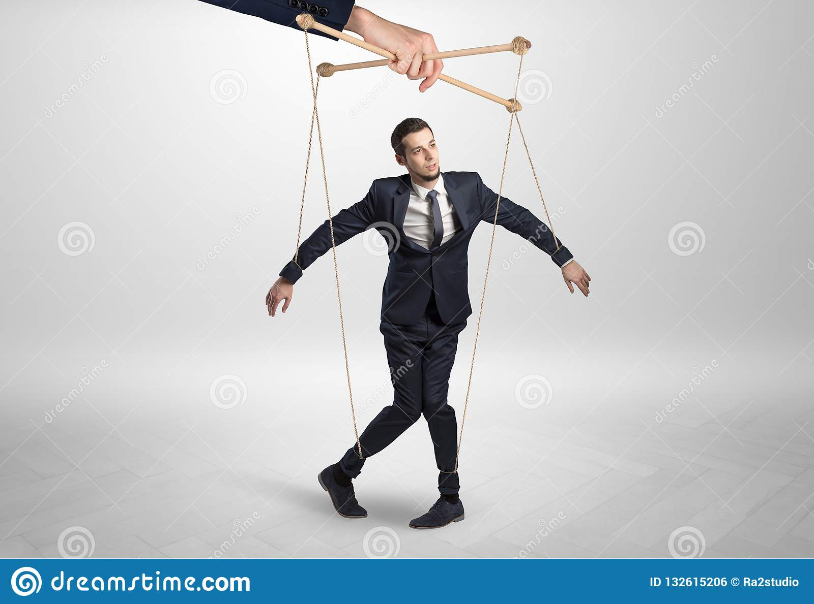 Puppet businessman leaded by a huge hand
