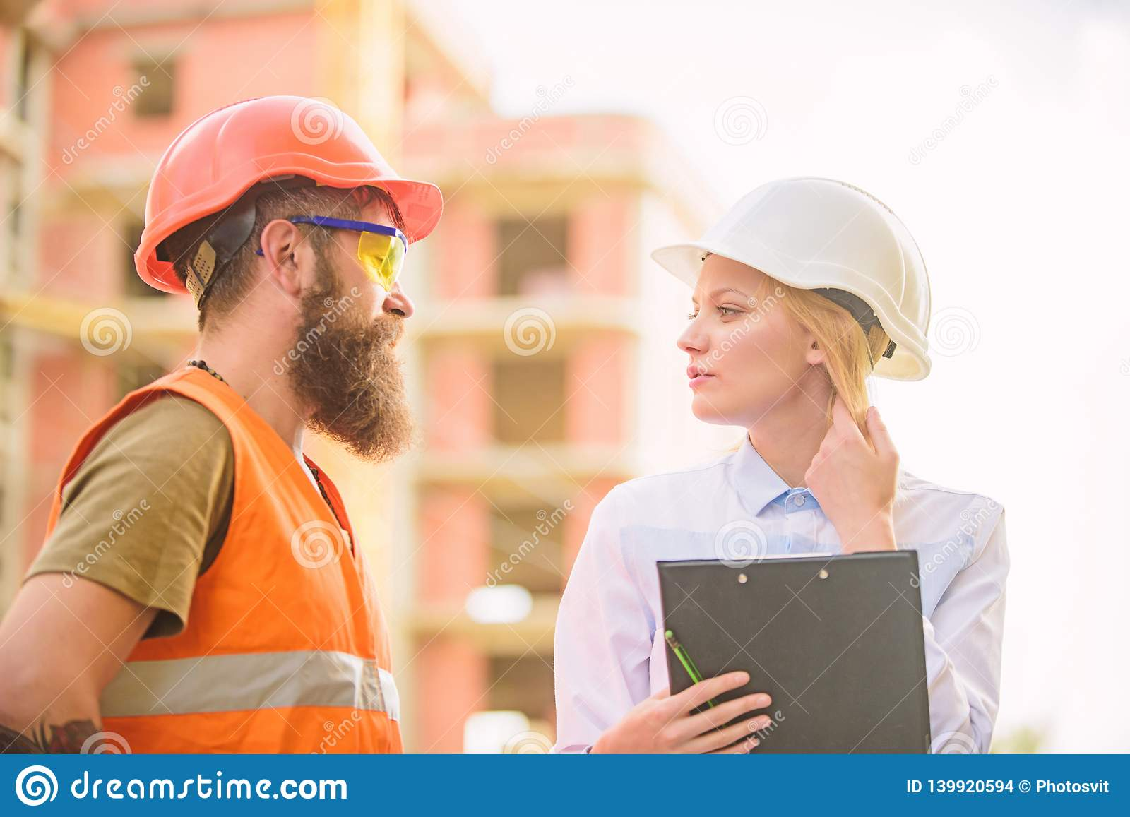 Purchase of building materials. Construction industry. Successful deal concept. Foreman established supply of building