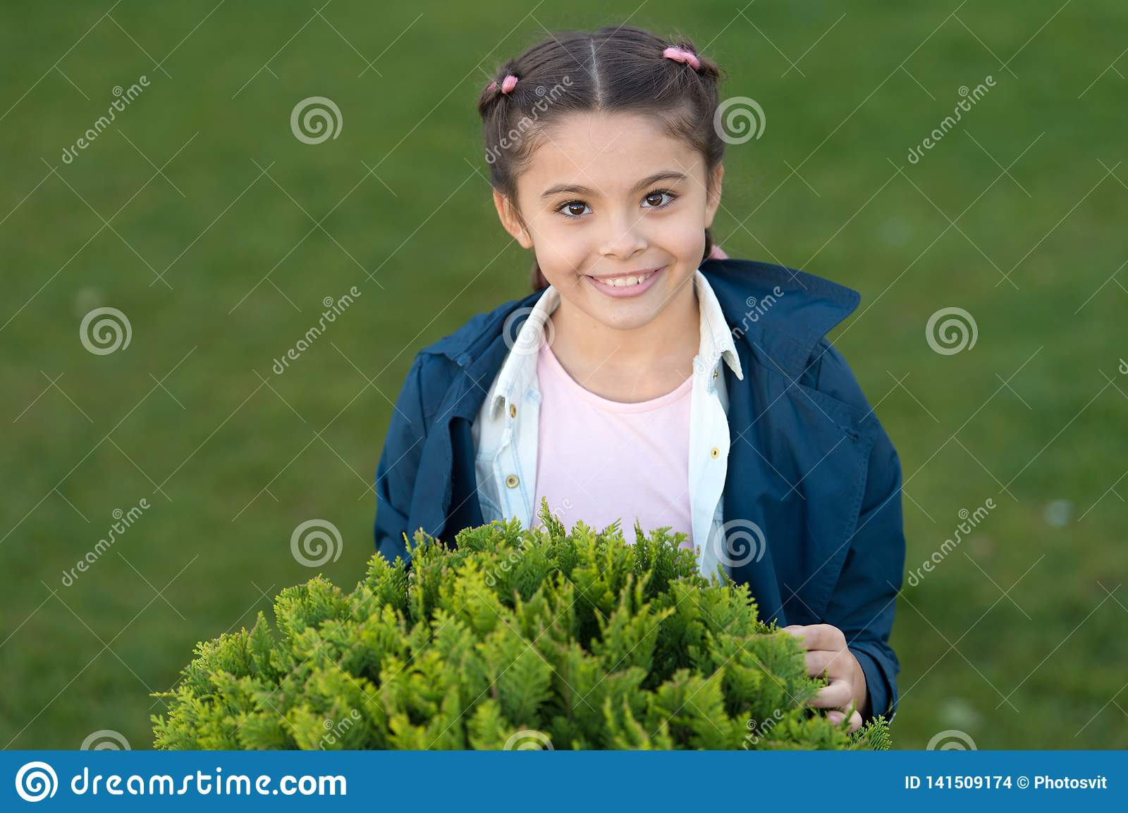 Pure smile. Honest smile of healthy kid. Autumn weather. Spring fashion for little girl. Park outdoor. Happy child with