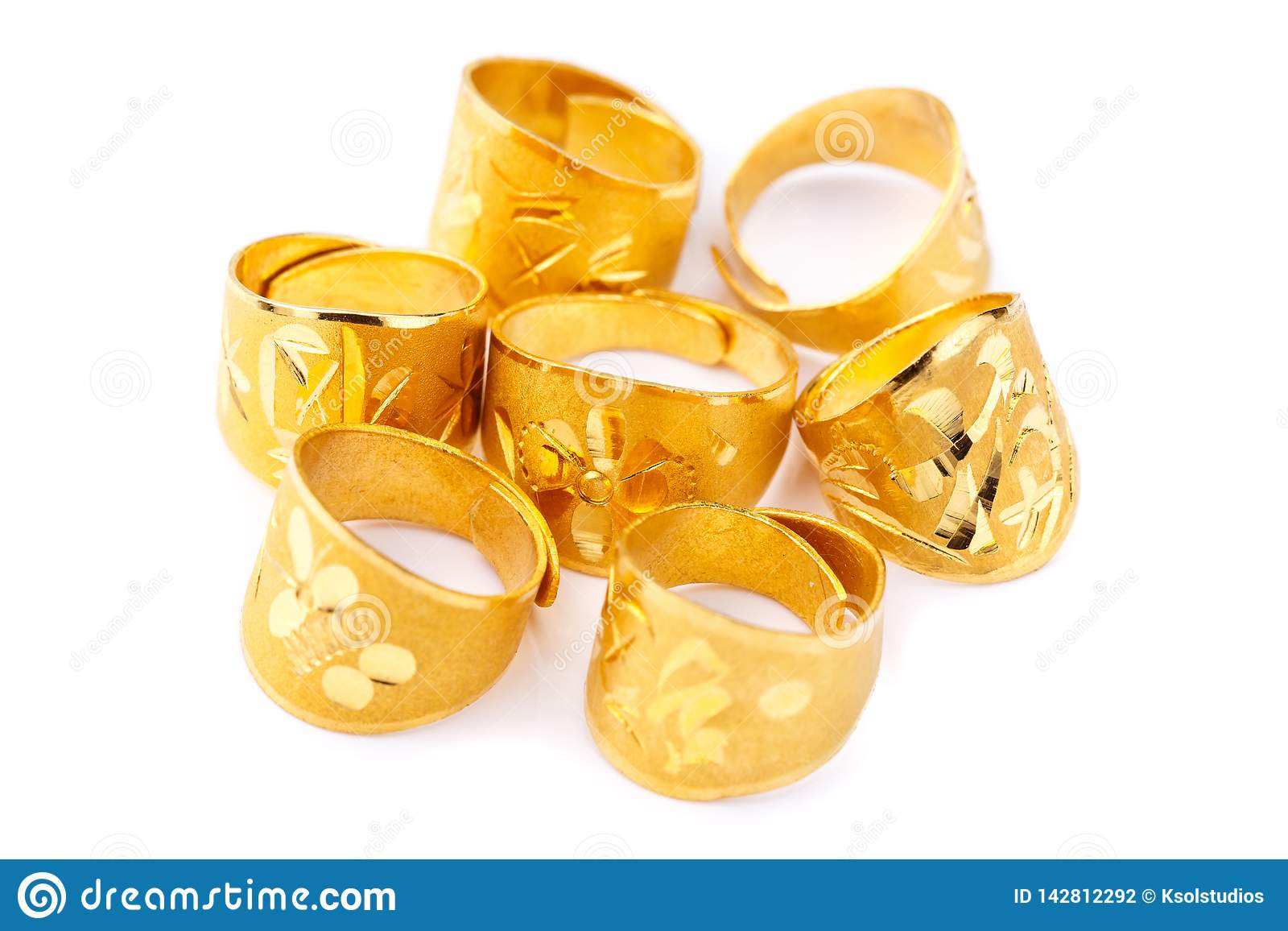 Pure solid gold rings on white background