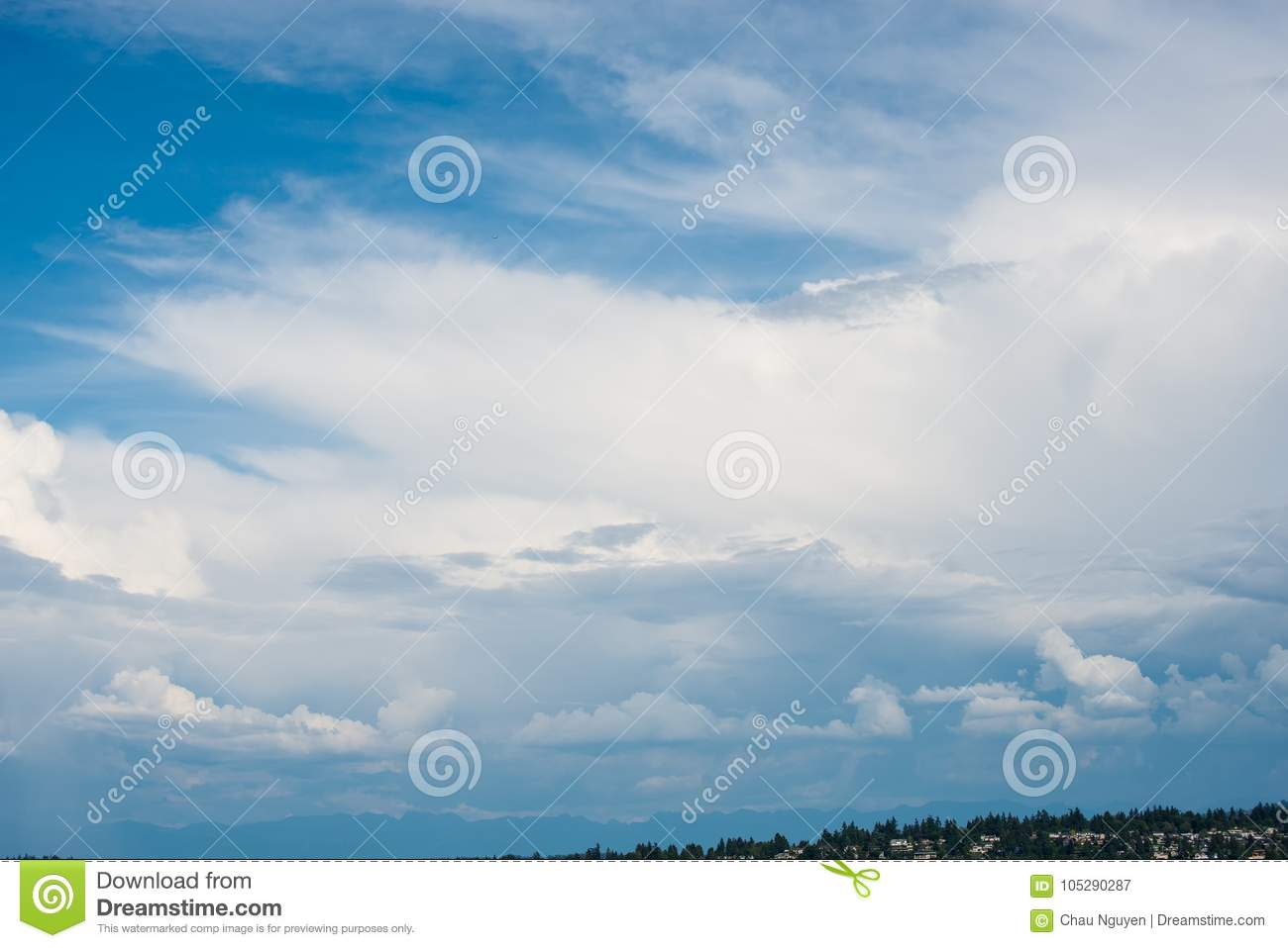 Beautiful clear blue sky with layers of white clouds flying by