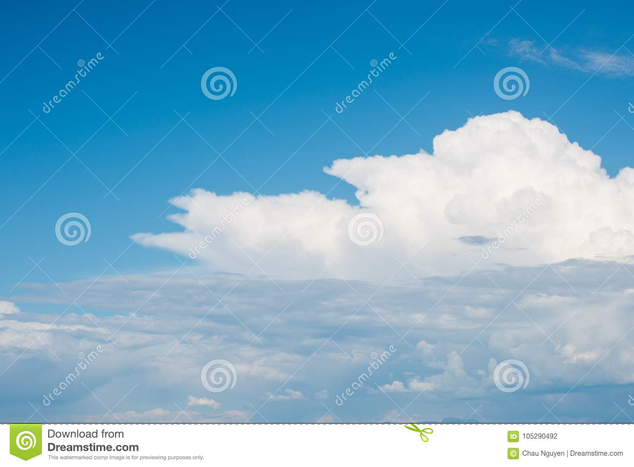 Beautifuly clear blue sky with layers of white clouds flying by