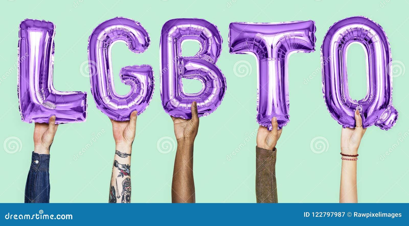 Purple alphabet balloons forming the word LGBTQ
