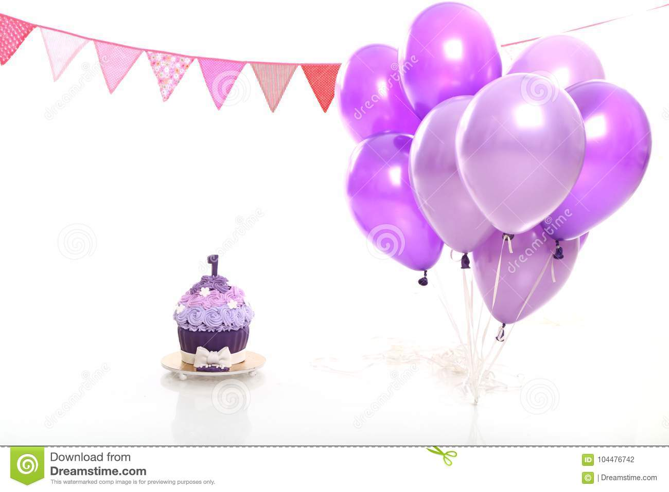 Birthday Cake And Balloons On White Background In The Studio