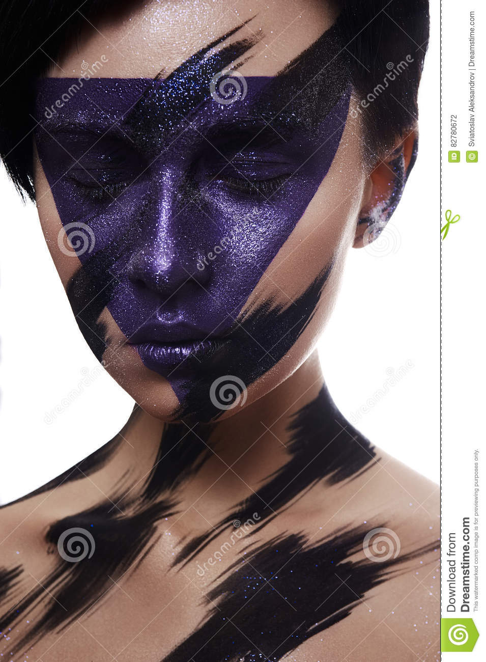 Purple and black Paint Makeup on Face of Model