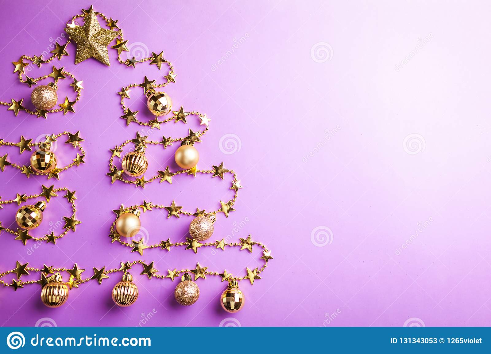 purple christmas and new year background with christmas tree made of toys space