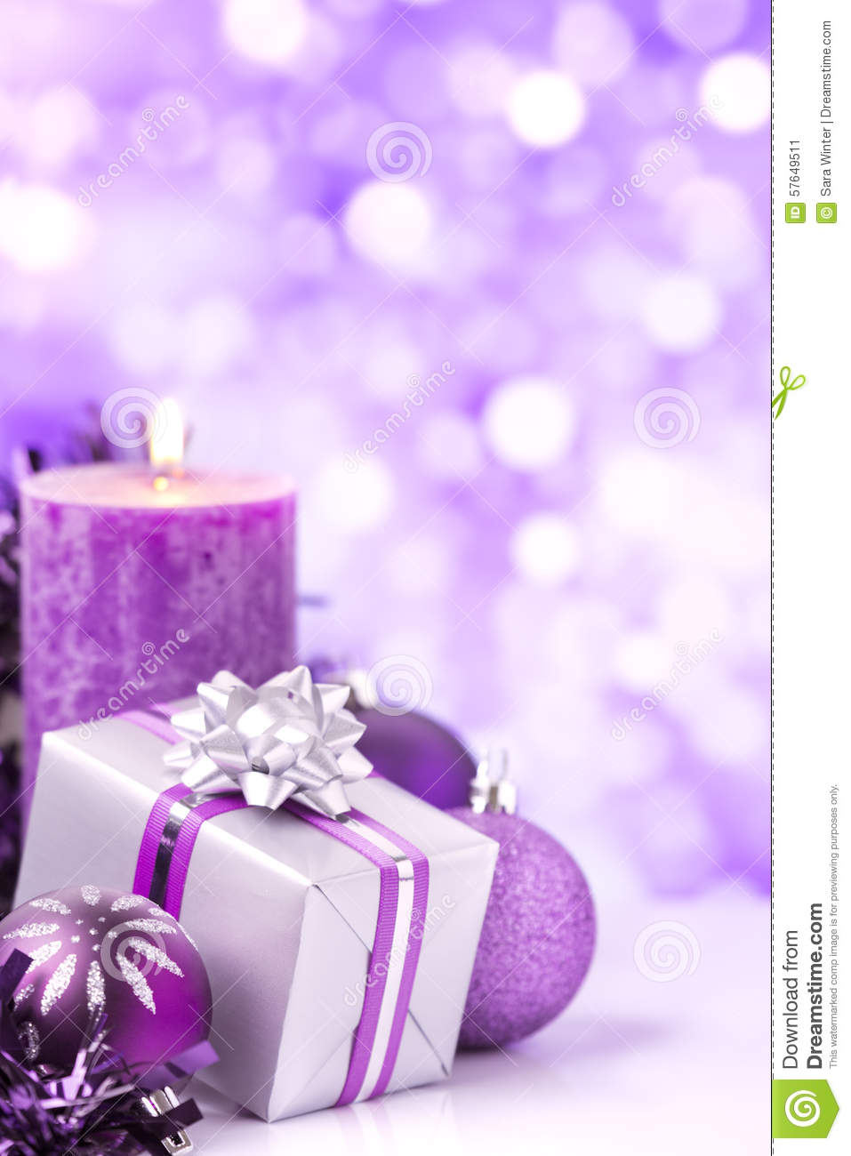Purple Christmas Scene With Baubles Gift And Candles