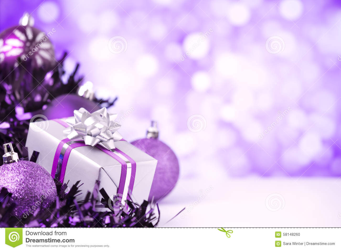 Purple Christmas.Purple Christmas Scene With Baubles And Gift Stock Photo