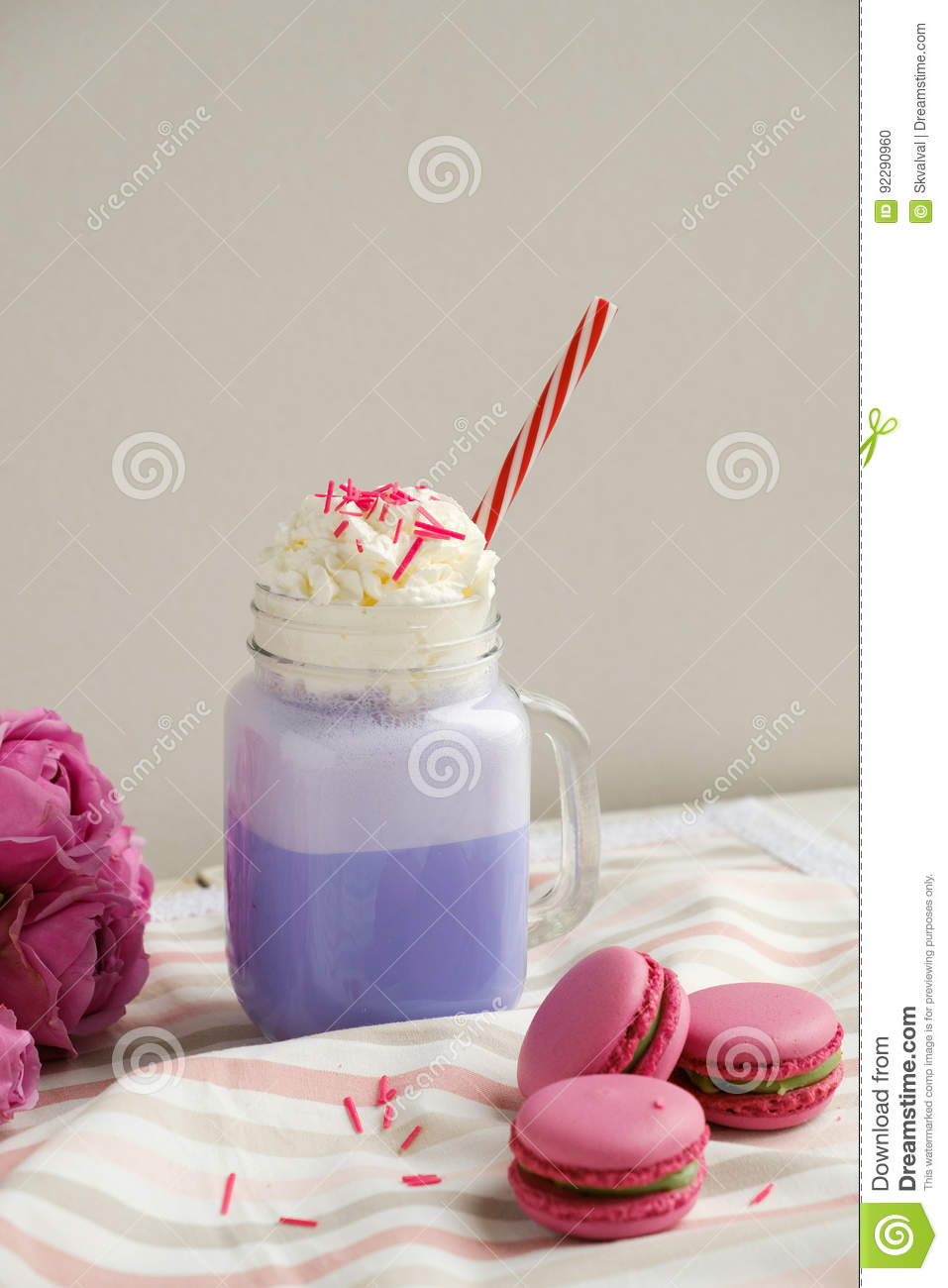 Purple Coffee In Stylized Mason Jar Cup With Macarons And