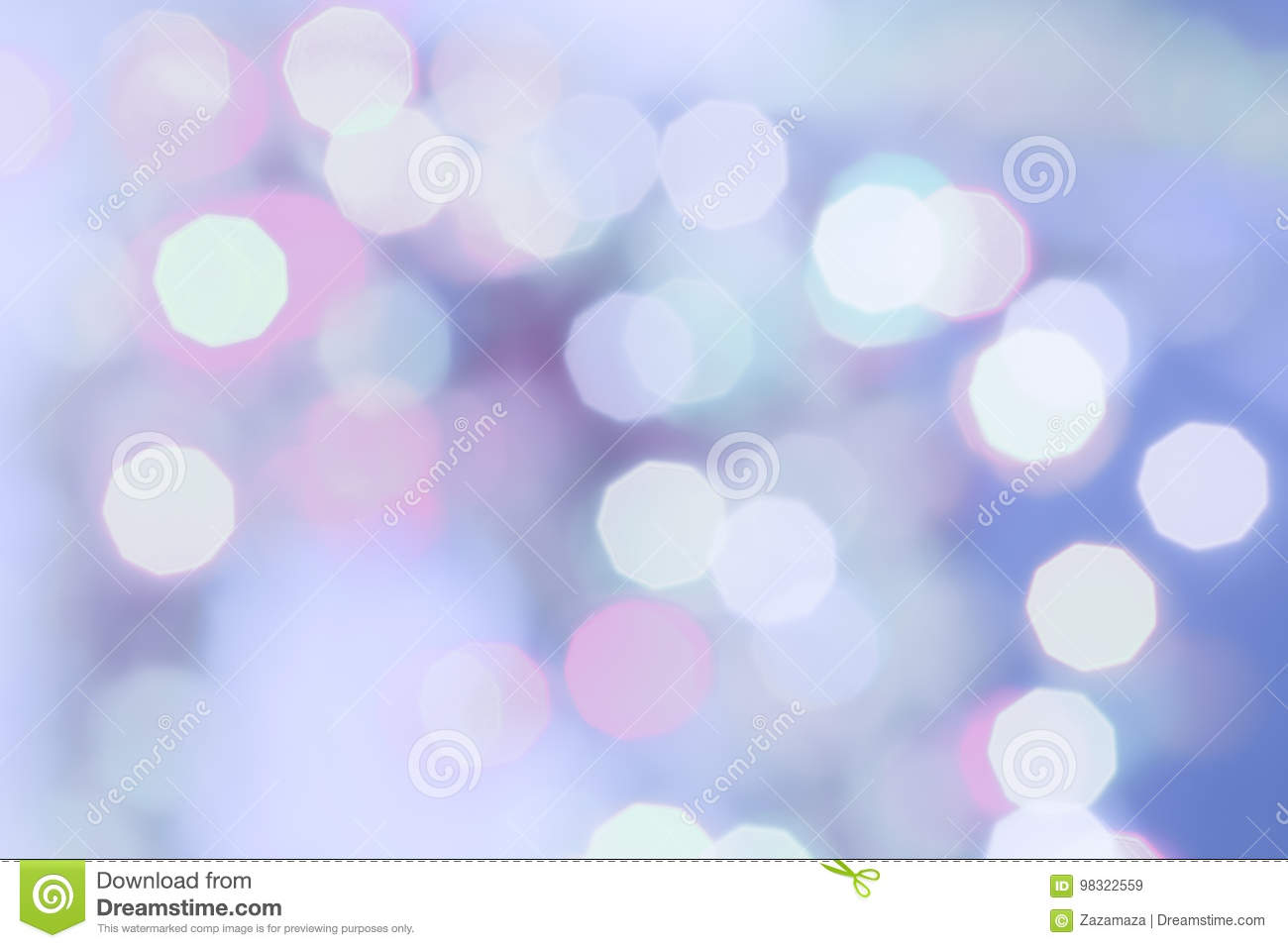 Purple colored Christmas bokeh light abstract holiday background.