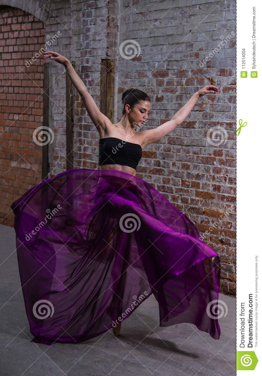 Purple floating tissue on a beautiful dancer