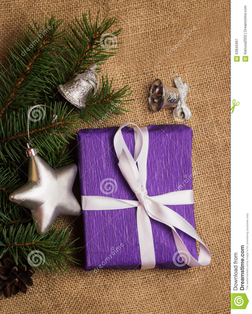 Purple gift christmas decorations fir cones stock photo for Fir cone christmas tree decorations