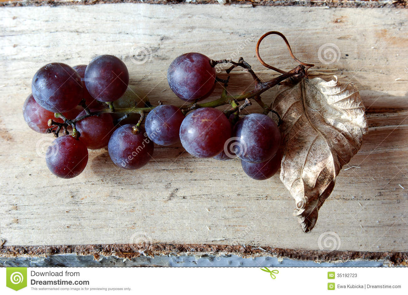 Purple Grape Branch On Wood Background Stock Photos - Image: 35192723