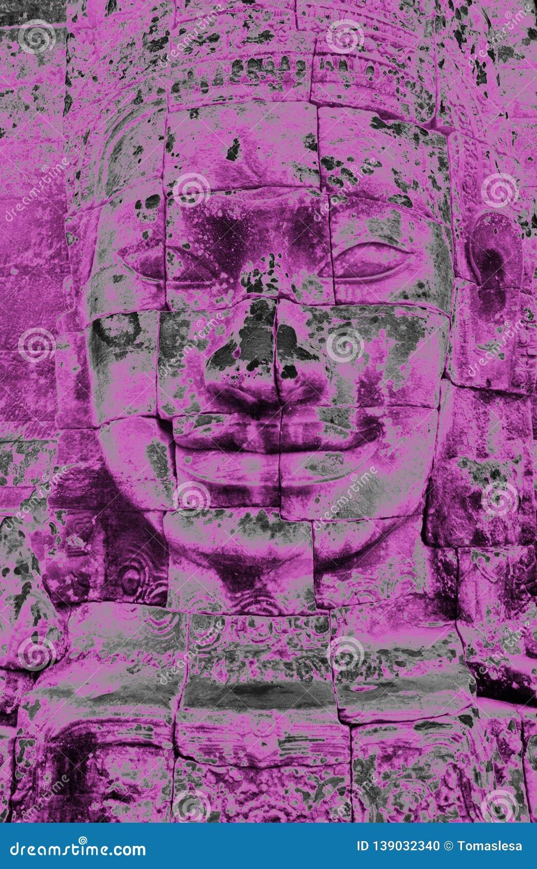 A purple head statue in Bayon Temple in Angor in Cambodia