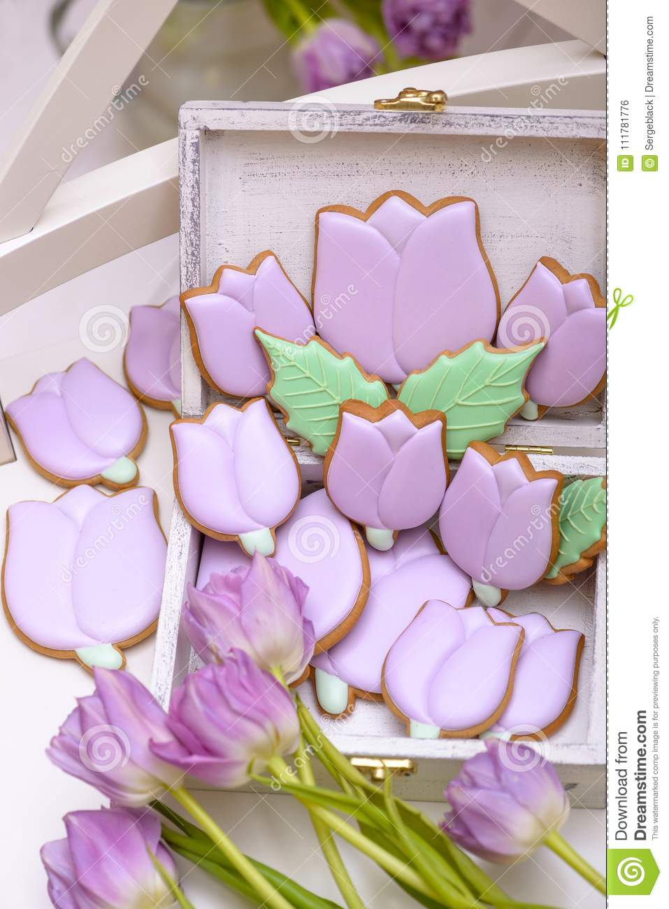 Purple homemade gingerbread cookies in the shape of tulips