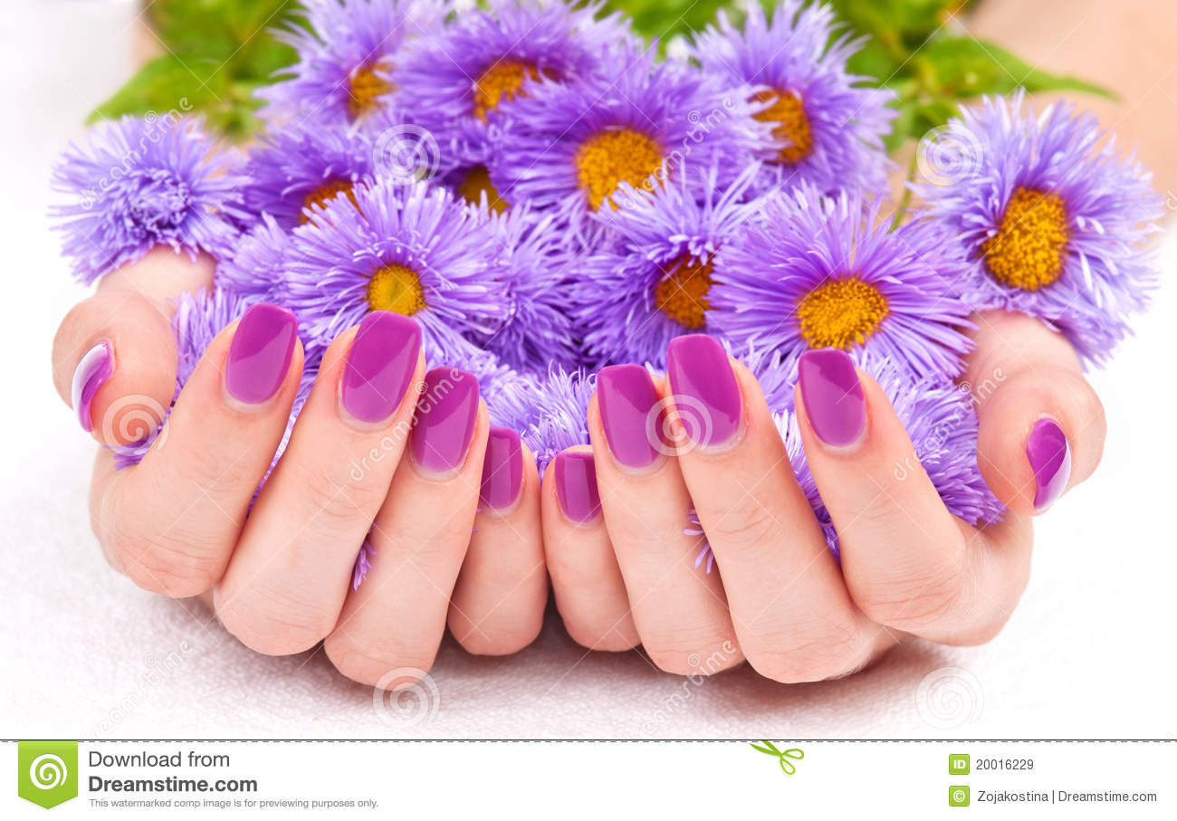 Purple manicure and flowers