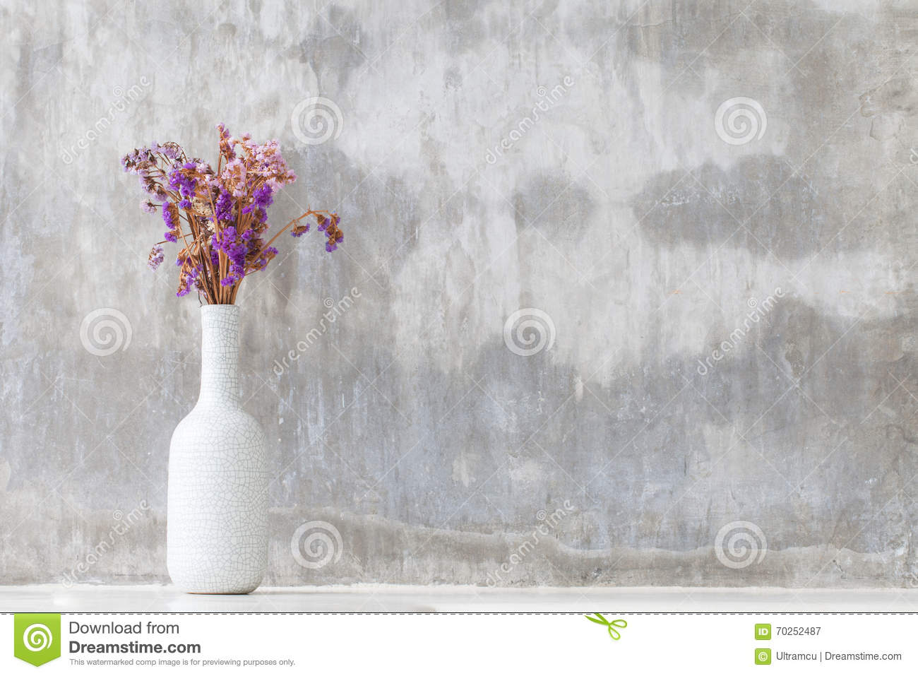 Purple orchid flowers in white vase