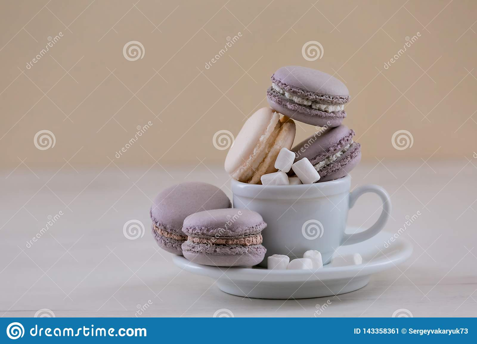 Purple macaroons in the cup.