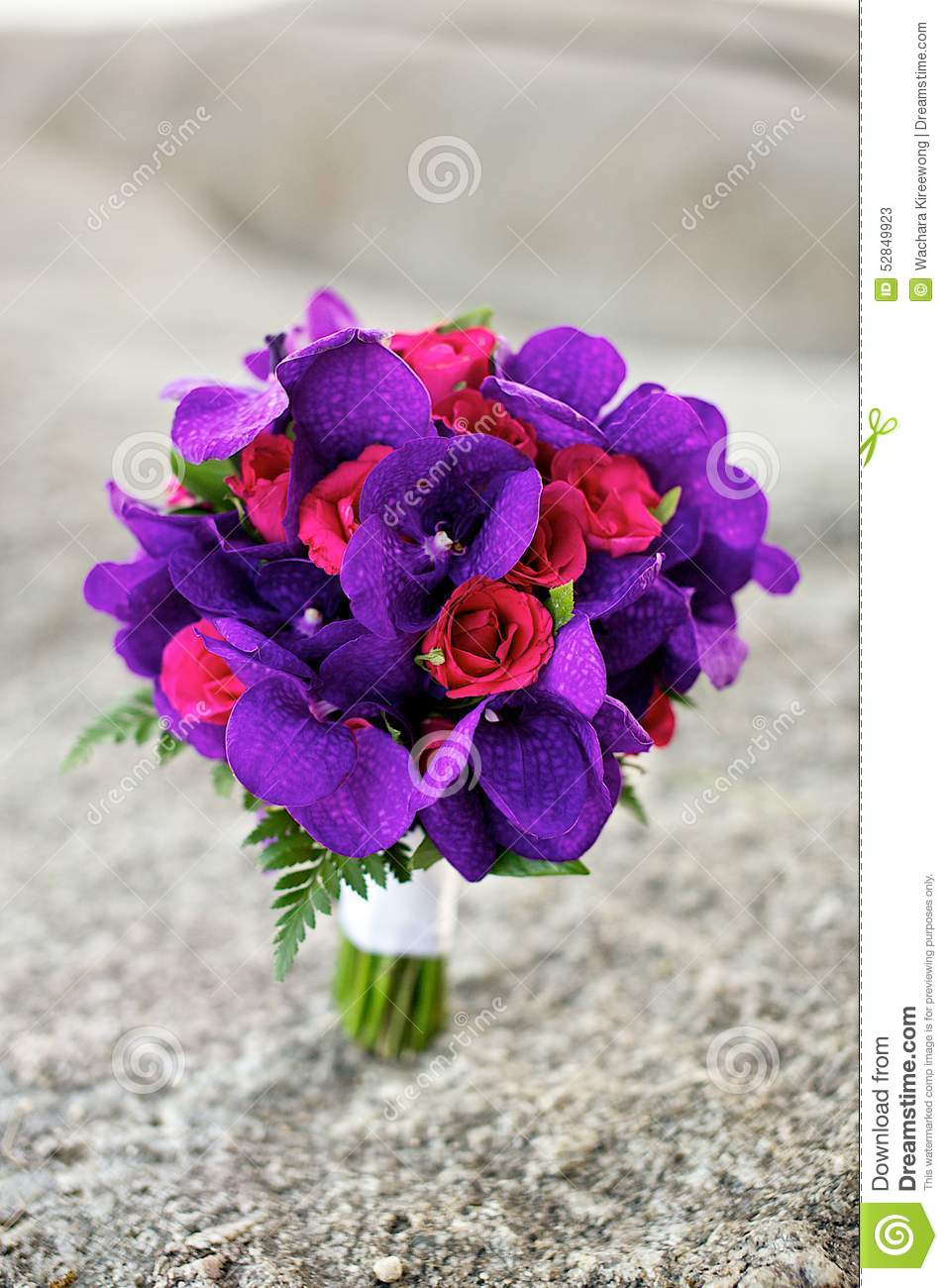 Purple And Red Flowers Wedding Bouquet On The Beach Stock Image