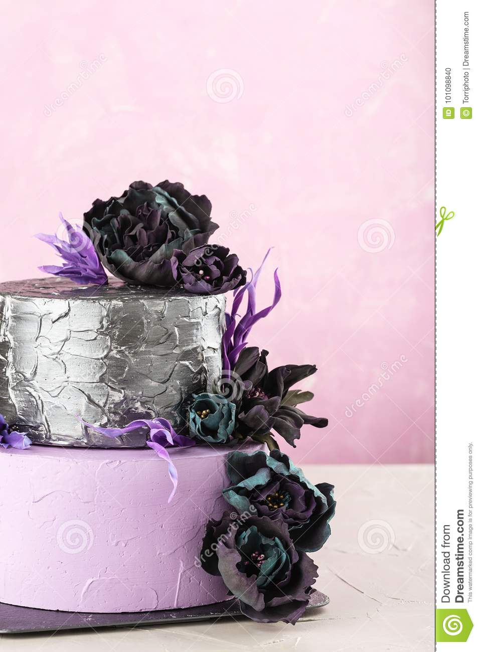 Tiered Wedding Cake With Black Fake Flowers On Pink Background Stock ...
