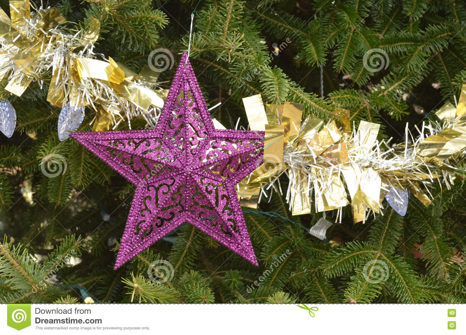 Purple star christmas ornaments gold silver tinsel garland stock