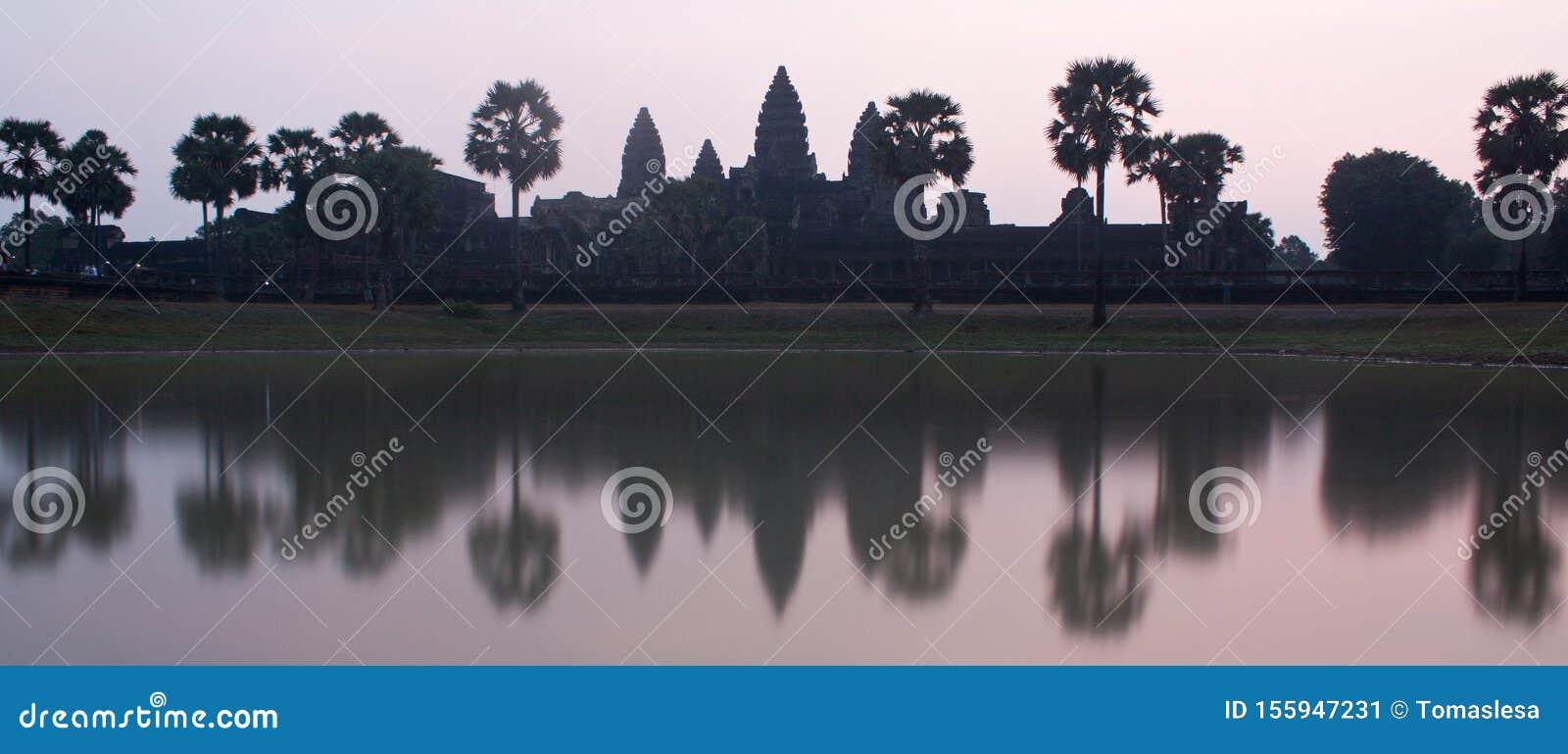 A purple sunrise photo of UNESCO Angkor Wat Temple near Siem Reap in Cambodia
