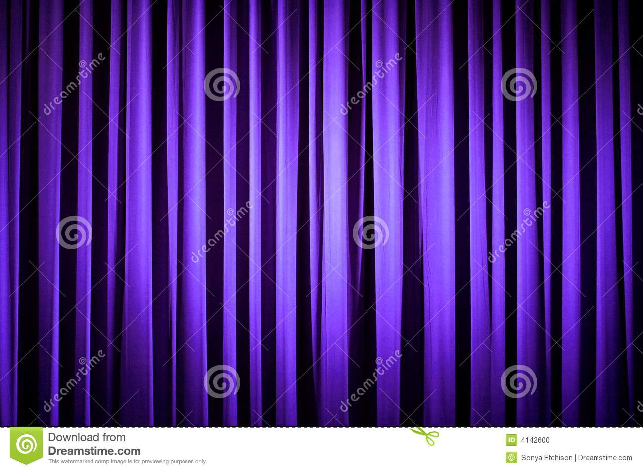 Purple theater curtain with a spotlight shining on it