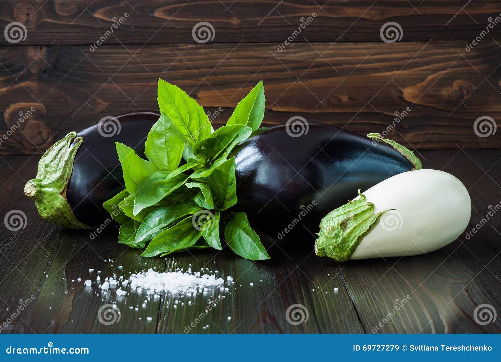 Purple And White Eggplant Aubergine With Basil On Dark