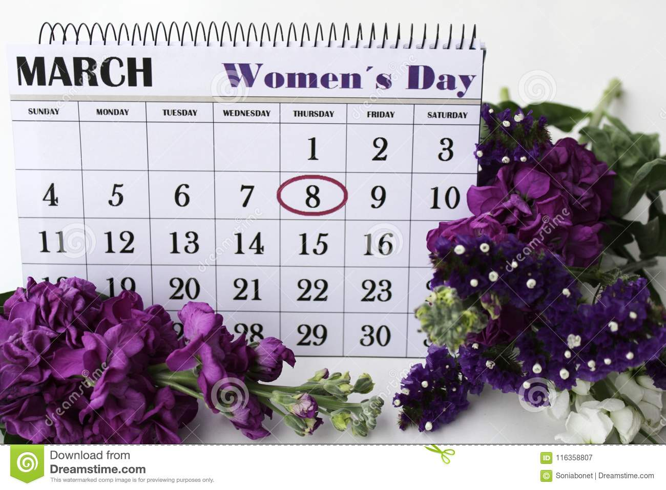 Liliums and Helichrysum flowers and calendar with marked Womens Day.