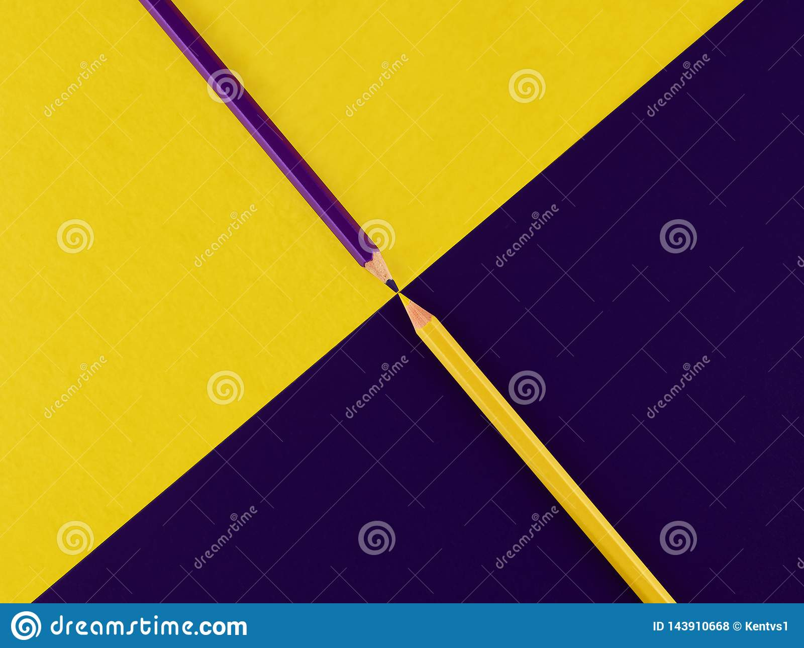 Purple and yellow pencils on a contrasting background
