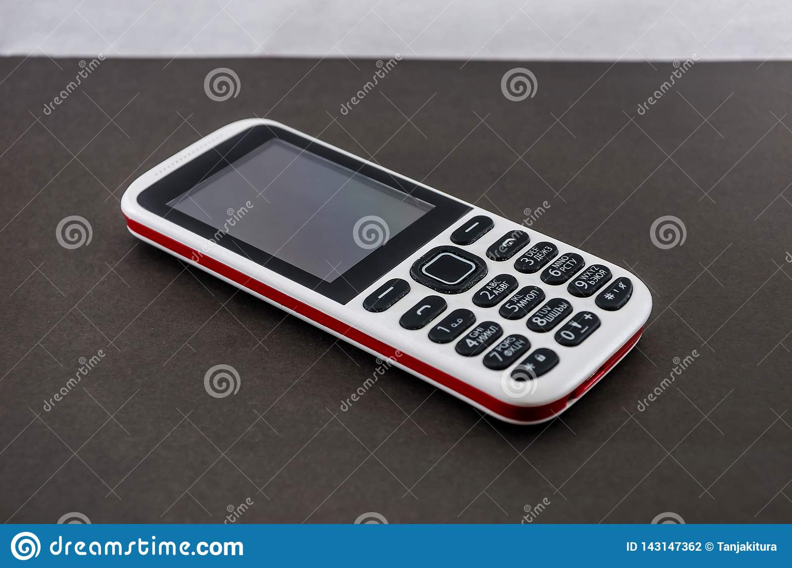 Push-button mobile phone on a gray background